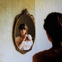 Não gosto do que vejo no espelho..